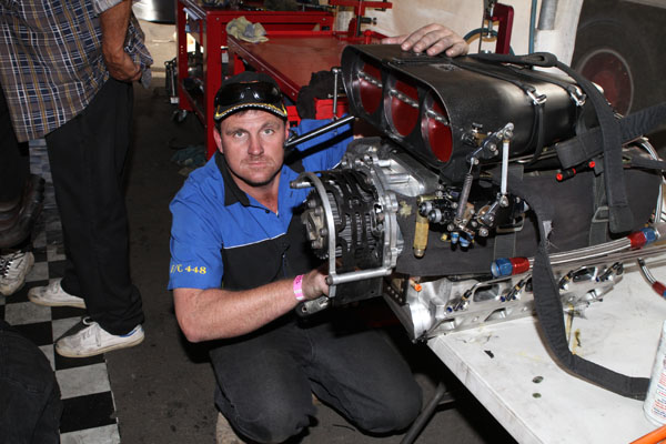 Chris Stipanovich with drag racing supercharger