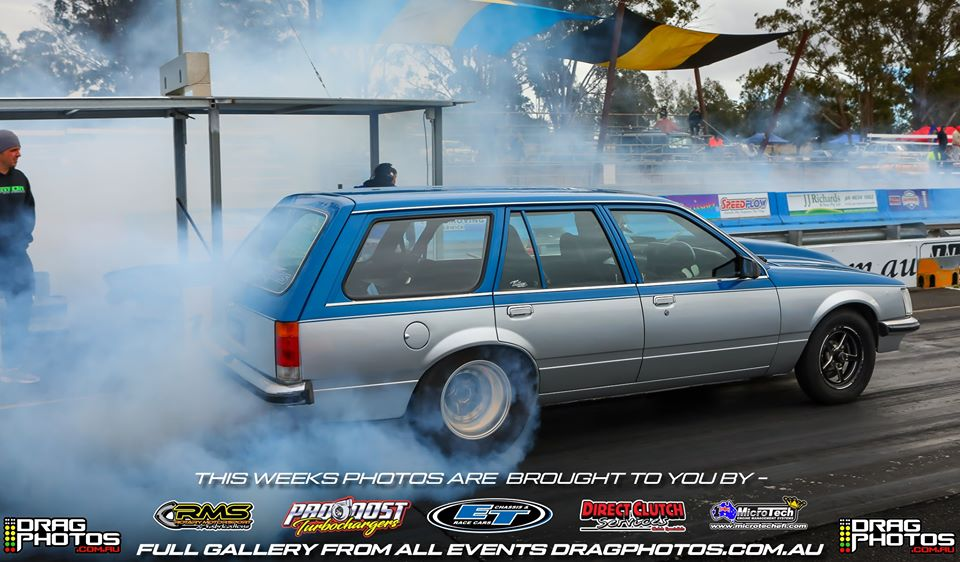 Holden station wagon doing burnout at drag race