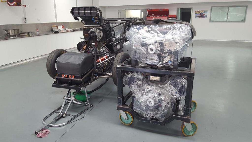 Drag racing engines next to car